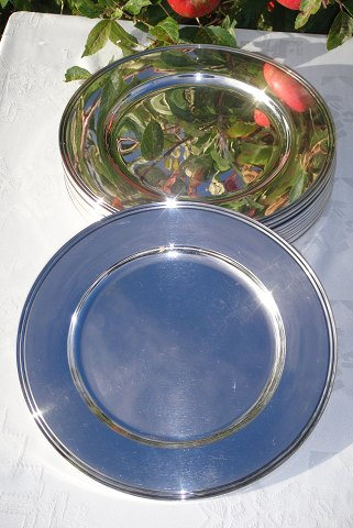 A set of twelve dinner charger plates sterling silver