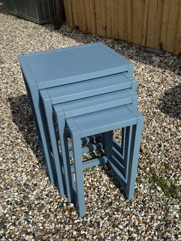 A set of nesting tables, painted blue. 5000m2 showroom.