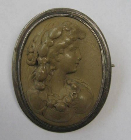 Large Came Brooch, c. 1900, carved in stone, with woman in profile. In oval silver setting