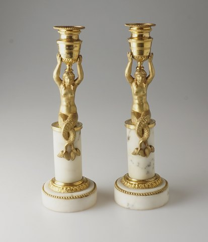 Pair of gilded candle holders with mermaids