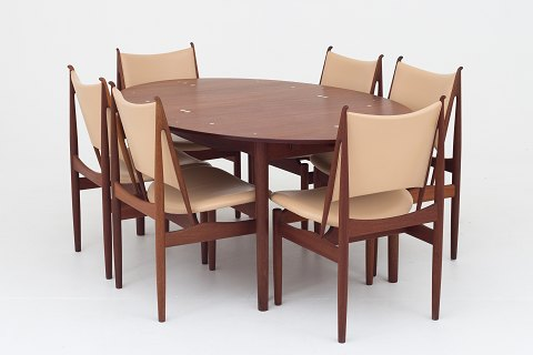 "Finn Juhl / Cabinetmaker Niels Roth Andersen Dining room in mahogany consisting of eight ""Egyptian chairs"" and a ""Judas"" dining table. Egyptians chairs in mahogany w. seat and back in natural leather and dining table in mahogany with circular silver inlays and two matching extension leaves. Good condition Location: KLASSIK Flagship Store - Bredgade 3, 1260 KBH. K."