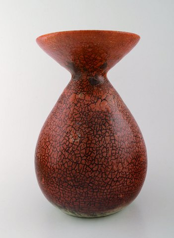 Accolay, French ceramic vase. red glaze, stylish design. Stamped. 1950/60 s.