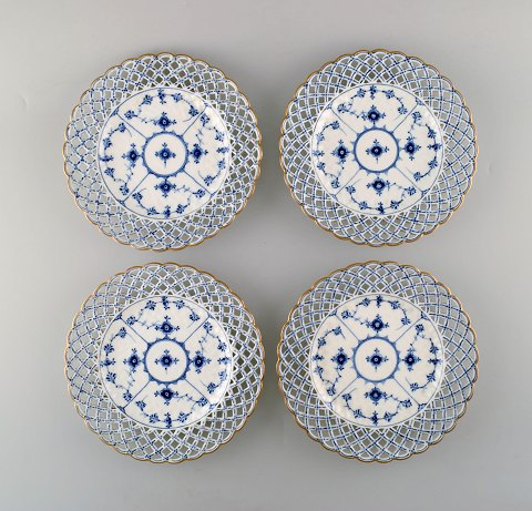A set of 4 antique Royal Copenhagen Blue Fluted full lace plates with gold rim.