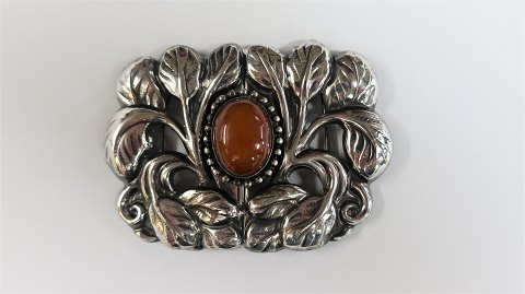 Christian Vilhelm Carl Larsen. Silver (830). Belt buckle with amber.