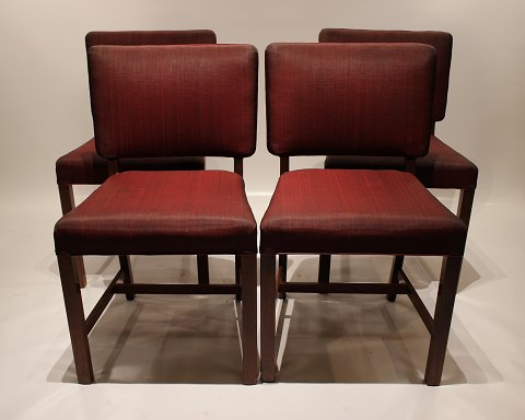 Set of four dining chairs of mahogany and red fabric by Fritz Hansen and from the 1930s. 5000m2 showroom.