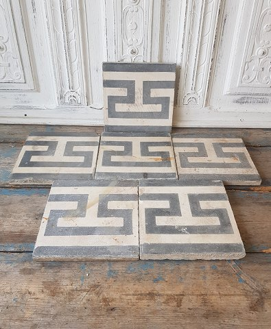 Antique tiles with Greek eternity pattern - a la grecque.