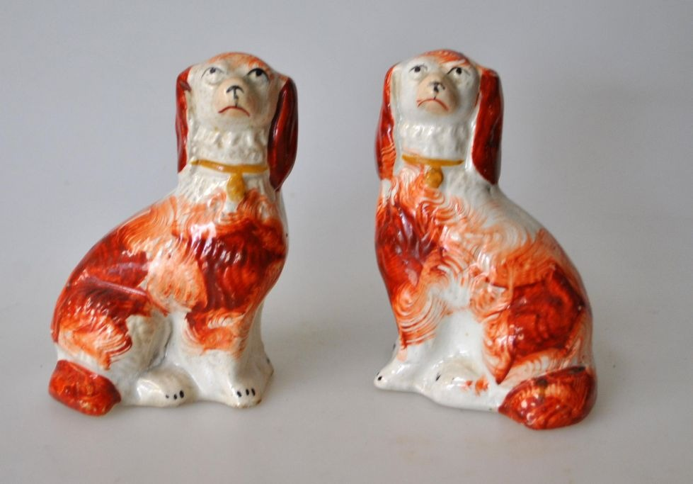 Pair of smaller Straffordshire poodle dogs, 19th century England.