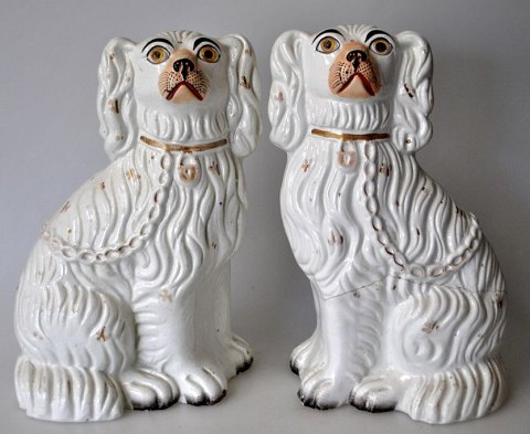 Pair of Straffordshire poodle dogs, 19th century England.