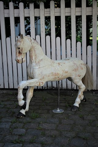 Decorative Swedish 1800's horse in carved wood with scraped original raw white color.