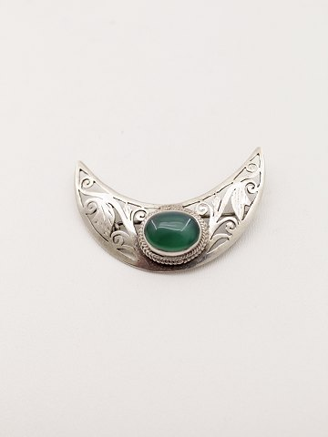 Silver brooch with cabochon chrysopras
