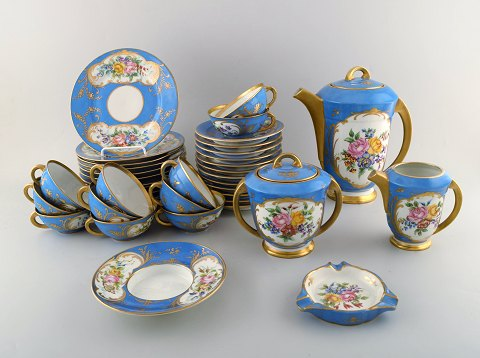 Sevres, Paris. Antique tea service in hand painted porcelain. Decoration in gold leaf. Complete for twelve people. 1890-1910.