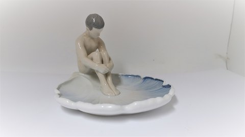 Bing & Grondahl. Boy sitting on waterlily leaf. Height 15 cm. Length 21 cm (1 quality)
