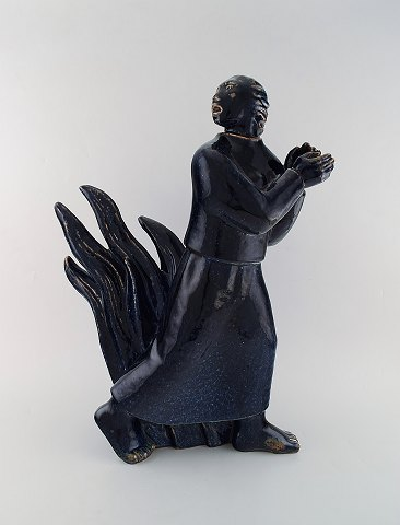 Jais Nielsen (1885-1961) for Royal Copenhagen. Large and impressive sculpture in glazed ceramics. Biblical motif in beautiful blue mussel glaze. Dated 1959.