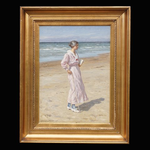 N. F. Schiøttz-Jensen, 1855-1941: Woman at the beach at Lønstrup, Denmark. Oil on canvas. Signed and dated 1916. Visible size: 48x34cm. With frame: 66x80cm