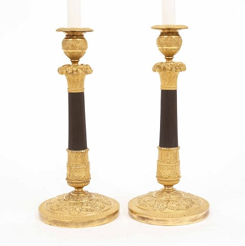 A pair of early 19th century gilt bronze candlesticks. France circa 1800. H: 33cm