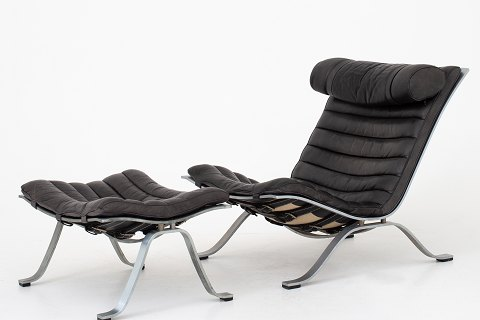 Arne Norell / Norell Möbel AB Ari easy chair w. ottoman in original black leather and brushed steel. 1 pc. in stock Good condition Location: Roxy Klassik Showroom - Jorisvej 11, 2300 KBH. S.