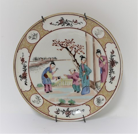 Royal Copenhagen. Antique plate with Chinese motif. Diameter 15.5 cm. Produced before 1900.