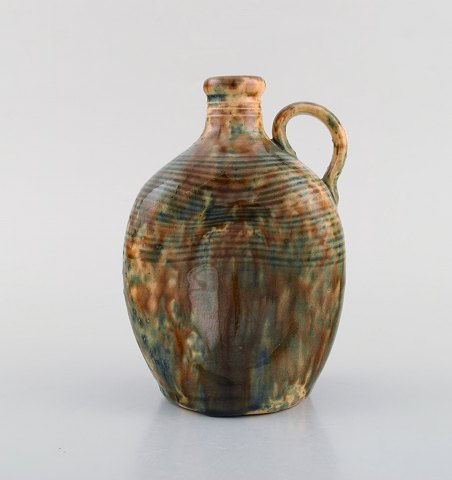 Gustaf Johnn for Höganäs. Antique art nouveau jug in glazed ceramic. Late 19th century.