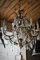 Large beautiful old chandelier with old gilded bronze frame and decorated with large clear glass prisms. H:90cm. Dia.:75cm.